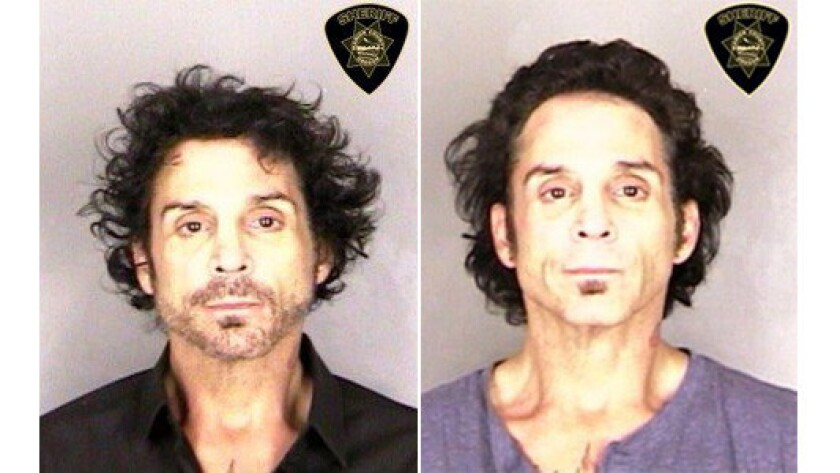 Journey drummer Deen Castronovo is shown in booking photos taken June 14, left, and June 29 by the Marion County Sheriff's Office in Salem, Ore.