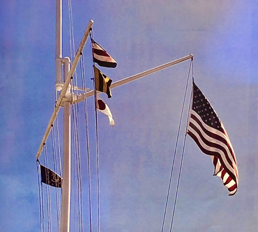 """These three signal flags, one over the other, send the San Diego Yacht club message, """"I will stand by to assist you."""""""