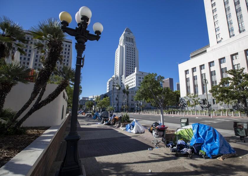 Homeless sleeping in tents line the sidewalk along Los Angeles Street in downtown Los Angeles Thursday, Jan. 21, 2021.