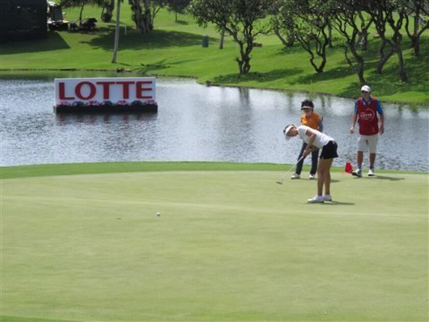 LPGA golfer Michelle Wie hits a putt on the 18th hole during a Pro-Am event a head of the LPGA Lotte Championship in Kapolei, Hawaii on Tuesday, April 16, 2013. (AP Photo/Oskar Garcia)
