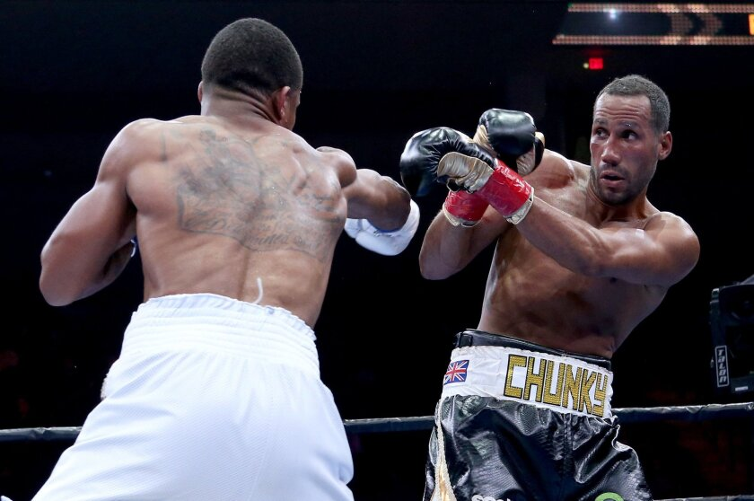 James DeGale, of England, right, blocks a punch from Andre Dirrell during a boxing match for the vacant IBF super middleweight title Saturday, May 23, 2015, in Boston. (AP Photo/Mary Schwalm)