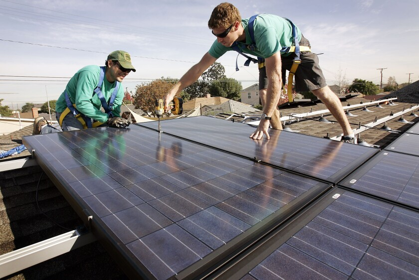SolarCity workers install panels