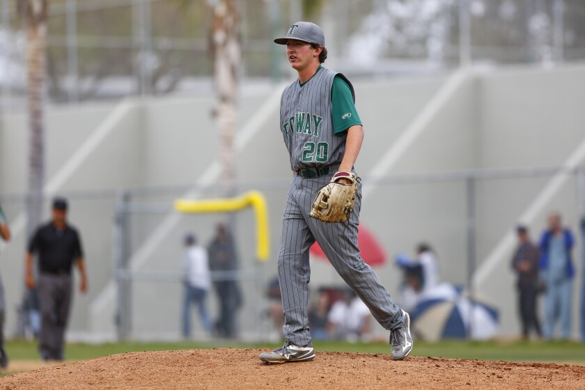Poway pitcher Dylan Moran walks off the mound after striking out Eastlake's Grant Holman in the 10th inning.