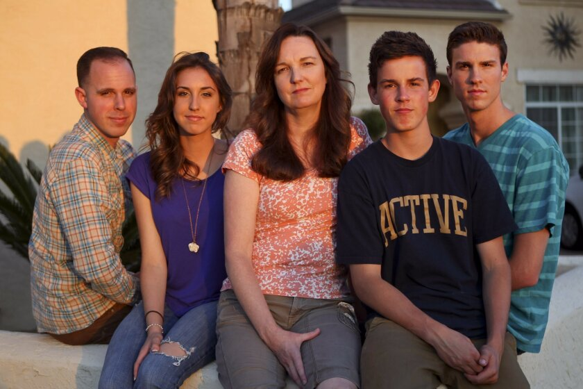 Susan Bertolino, center, with her children, from left, Tony, 23, Karina, 17, Jason, 15, and Daniel, 21, in front of their home in Murrieta on Monday. Army Staff Sgt. Stephen Bertolino, who was Susan's husband and the father her children, was killed in Iraq while deployed there in 2003.