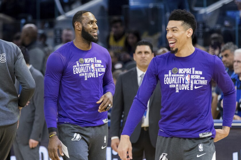 Lakers forward LeBron James, left, and guard Danny Green take part in warmups before a game against the Warriors on Feb. 8.