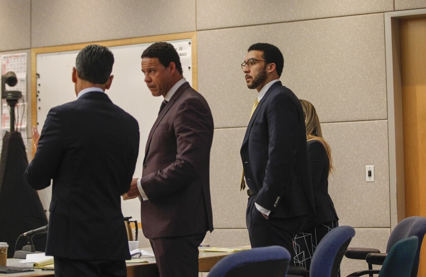 Kellen Winslow II (third from left) stands, along with his defense team (from left) Marc Carlos, Brian Watkins, and Emily Bahr, as the jury enters the room on Tuesday during the second day of the verdict readings at Vista Superior Court on Tuesday, June 11.