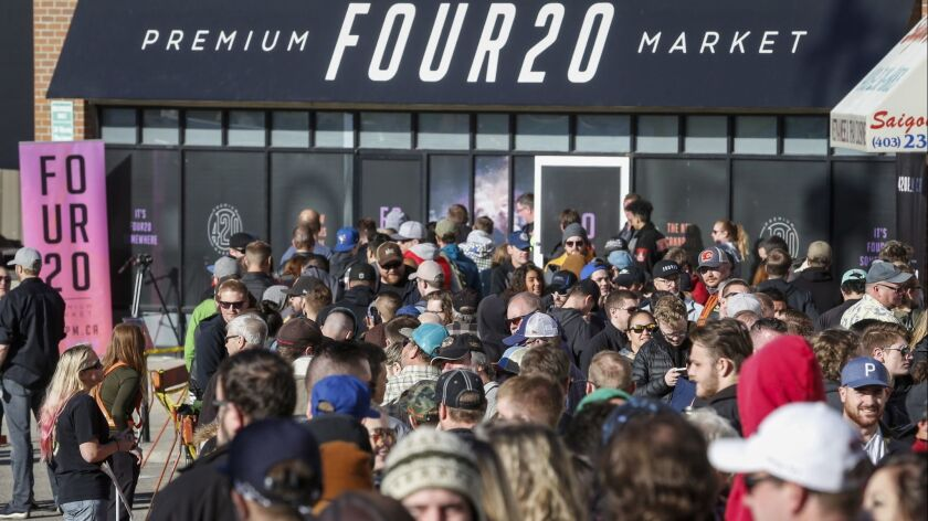 People line-up to purchase legal cannabis in Calgary, Alberta, Wednesday, Oct. 17, 2018. Canada beca