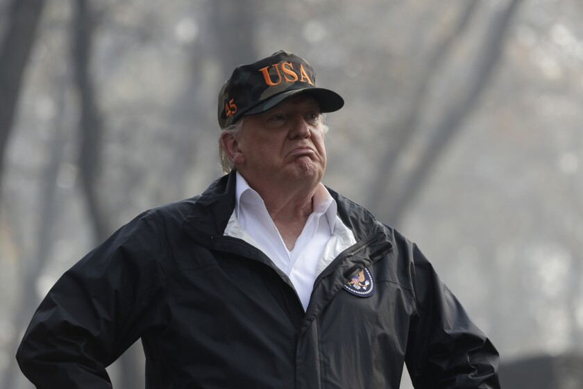 President Donald Trump visits a neighborhood impacted by the wildfires, Saturday, Nov. 17, 2018, in Paradise, Calif.