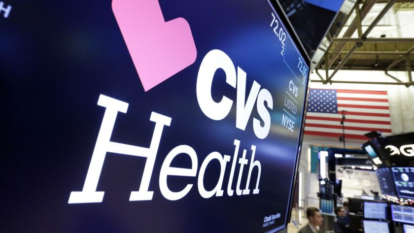 The CVS Health logo appears above a trading post on the floor of the New York Stock Exchange, Monday