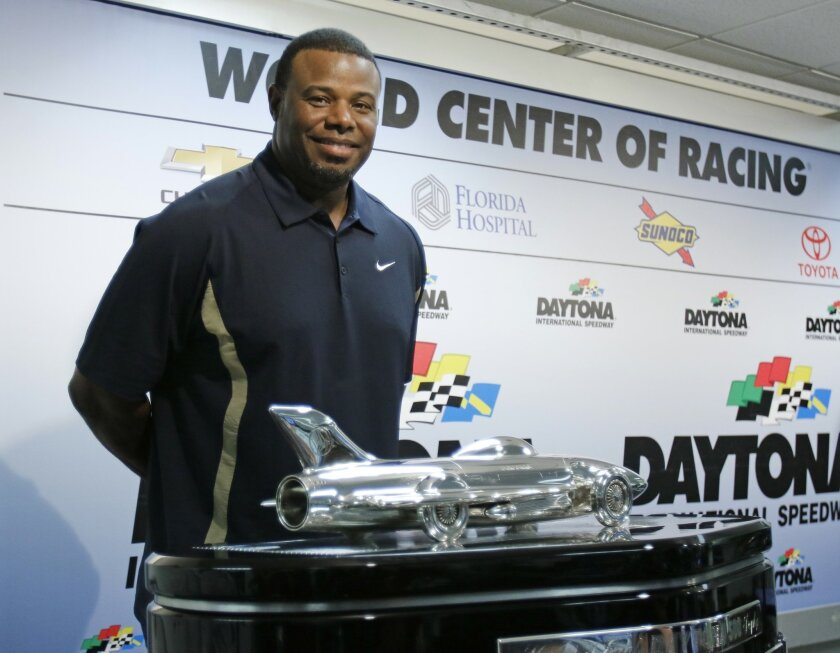 Baseball Hall of Fame centerfielder Ken Griffey Jr poses with the Daytona 500 winner's trophy during a news conference before the NASCAR Daytona 500 Sprint Cup Series auto race at Daytona International Speedway in Daytona Beach, Fla., Sunday, Feb. 21, 2016. Griffey is the honorary starter of the race. (AP Photo/Terry Renna)