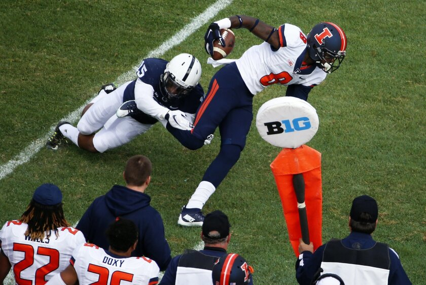 Illinois wide receiver Geronimo Allison (8) slips away from Penn State cornerback Grant Haley (15) after catching a pass from quarterback Wes Lunt during the first half of an NCAA college football game in State College, Pa., Saturday, Oct. 31, 2015. (AP Photo/Gene J. Puskar)