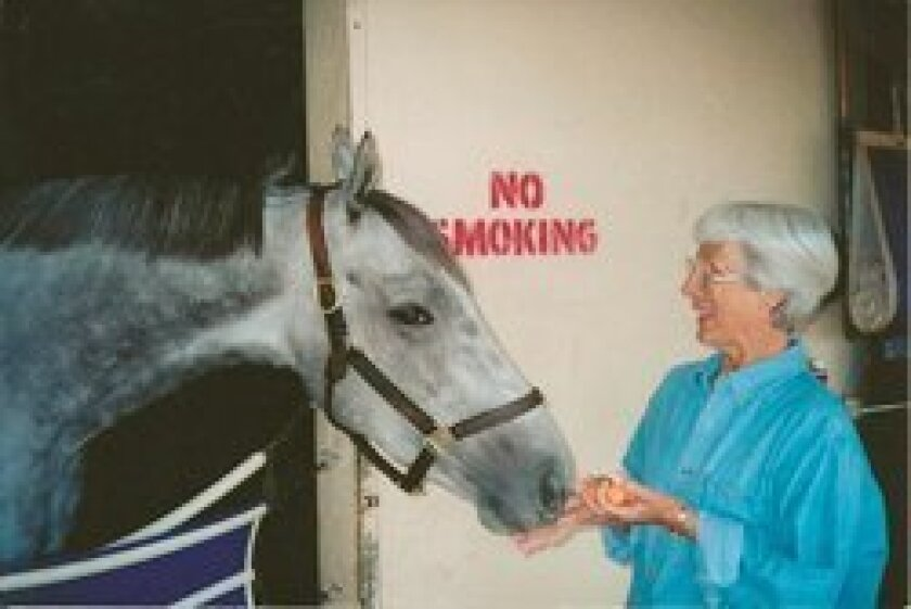 Fae Sanger with one of her horses, Silver Magic. (This photos was taken a few years ago.)