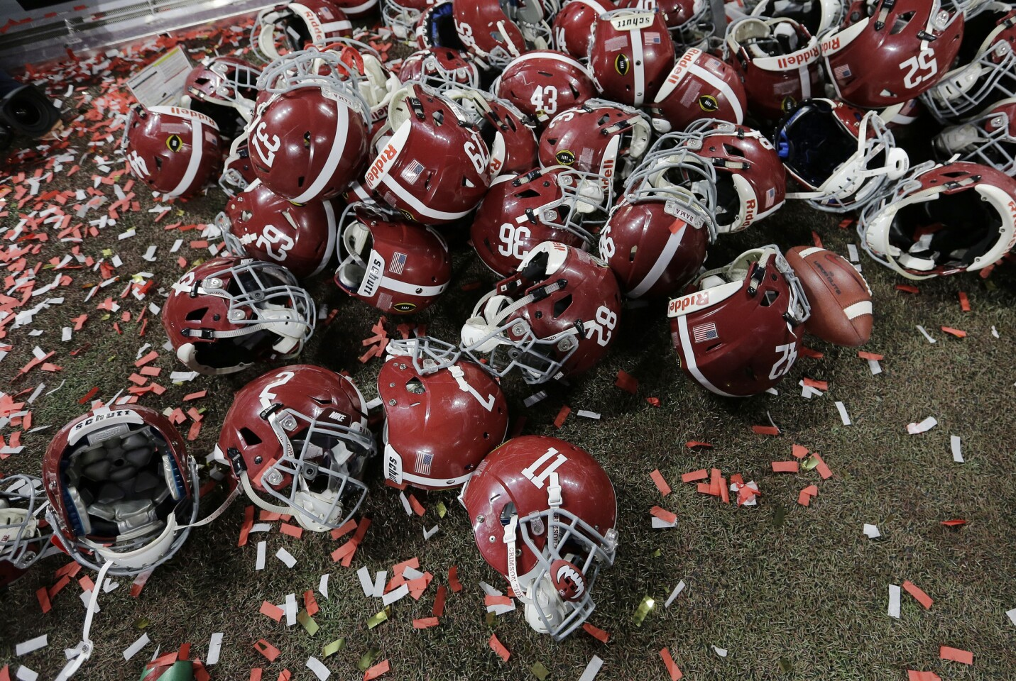 Alabama helmets lay with confetti after overtime.