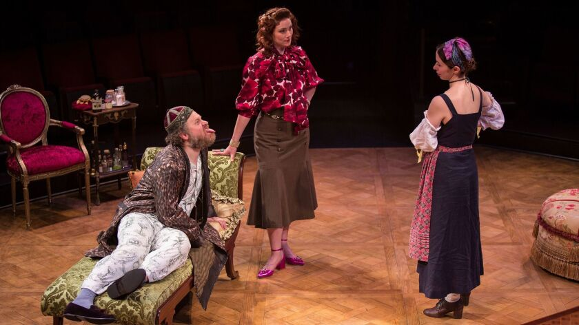 (from left) Andy Grotelueschen appears as Argan, Jessie Austrian as Béline, and Emily Young as Toin