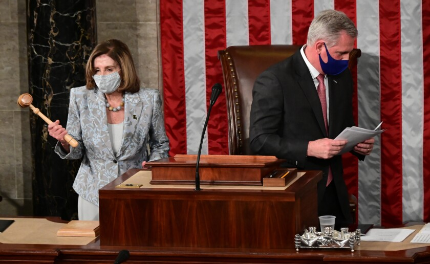 Speaker of the House Nancy Pelosi holds the gavel after House Minority Leader Kevin McCarthy handed it to her.