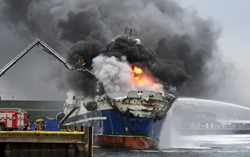 The Russian fishing trawler, Bukhta Naezdnik engulfed in flames in the harbour of Tromso, Norway, Thursday Sept. 26, 2019. A Russian trawler with an ammonia tank and some 200,000 liters of diesel oil inside is in flames at a northern Norwegian port and authorities have evacuated surrounding areas due to an explosion risk. (Rune Stoltz Bertinussen/NTB Scanpix via AP)
