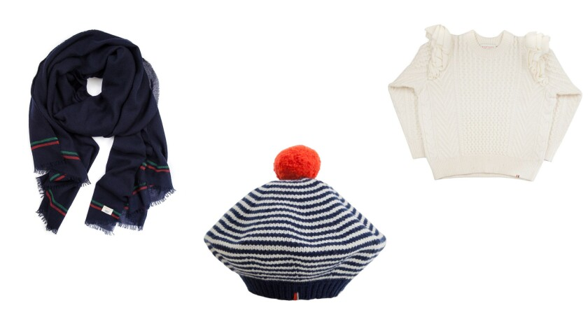 From left, a navy cashmere scarf with green and red stripes, $276; a navy and arctic white wool stri