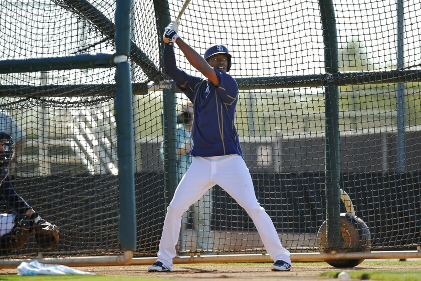 The Padres' Melvin Upton Jr. bats during a spring training practice.