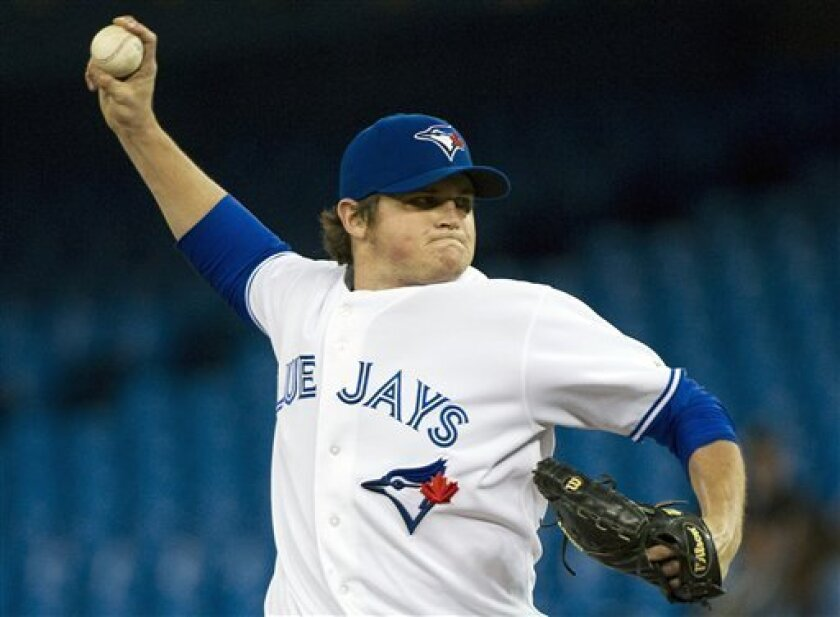 Toronto Blue Jays starting pitcher Chad Jenkins works against the Minnesota Twins during the first inning of a baseball game in Toronto on Tuesday, Oct. 2, 2012. (AP Photo/The Canadian Press, Nathan Denette)