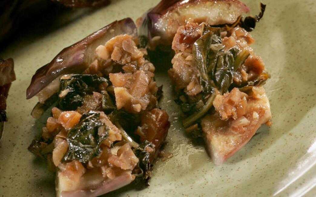 Eggplant stuffed with kale and walnuts