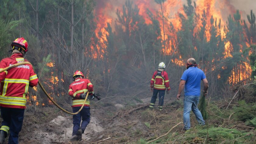 Firefighters combat a forest fire in Gaeiras, Marinha Grande, in Portugal, on Oct. 16, 2017.