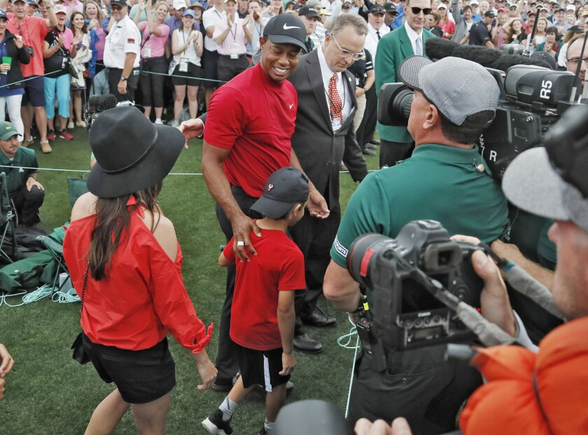 Tiger Woods is met by his son and daughter after he won the Masters on Sunday, April 14, 2019, at Augusta National Golf Club in Augusta, Ga. (Bob Andres/Atlanta Journal-Constitution/TNS) ** OUTS - ELSENT, FPG, TCN - OUTS **