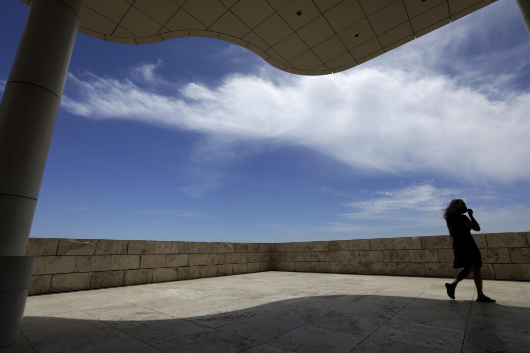 A visitor is framed by a portion of The Getty Center on the first day the museum reopened to the public in over a year.