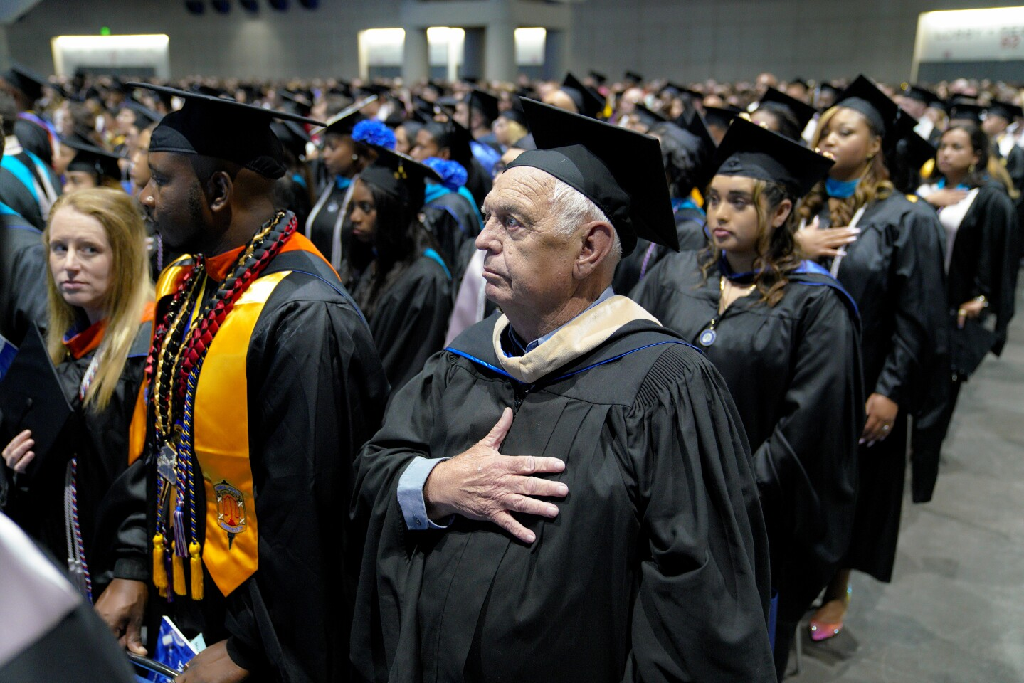 On Sunday at the San Diego Convention Center, George Donelson, 79 gets settled in for the national anthem during his graduation ceremony from National University, where he earned his Masters in criminal justice on June 30, 2019.