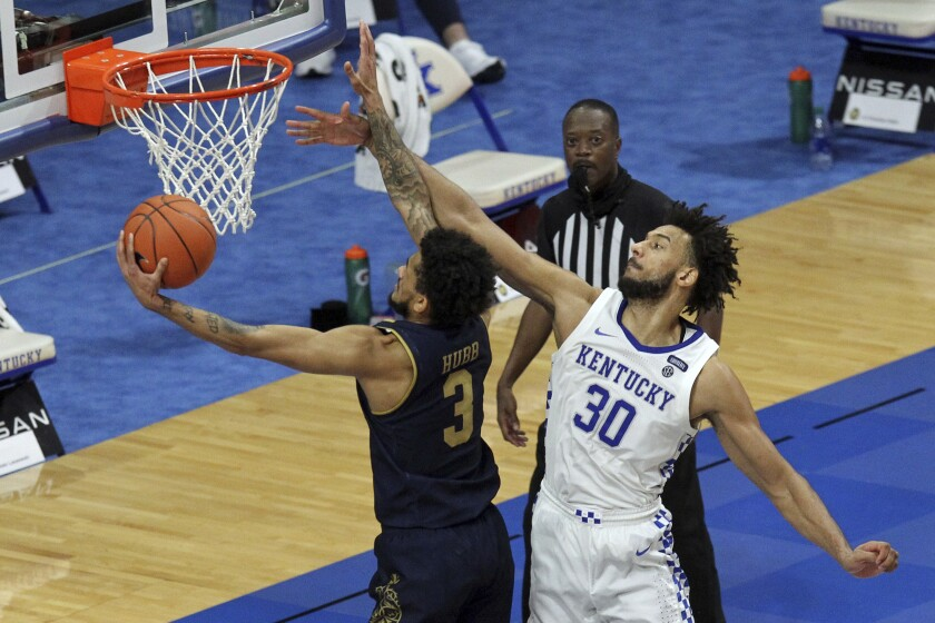 Notre Dame's Prentiss Hubb (3) shoots while defended by Kentucky's Olivier Sarr (30) during the second half of an NCAA college basketball game in Lexington, Ky., Saturday, Dec. 12, 2020. Notre Dame won 64-63. (AP Photo/James Crisp)