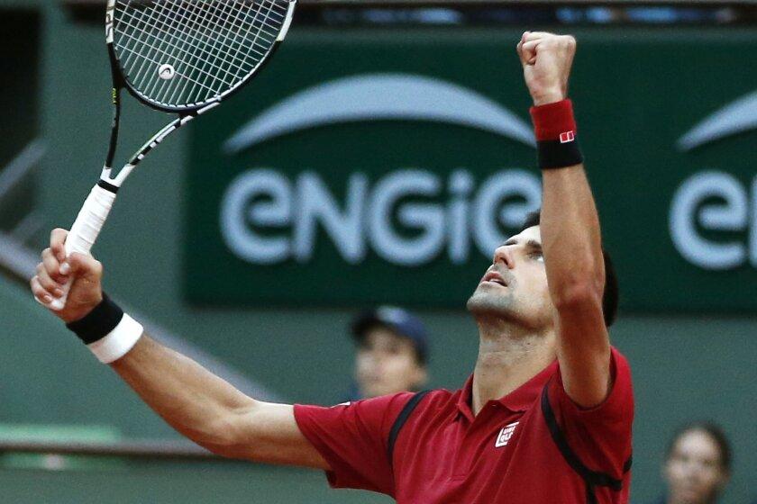 Serbia's Novak Djokovic celebrates winning his third round match of the French Open tennis tournament against Britain's Aljaz Bedene at the Roland Garros stadium in Paris, France, Saturday, May 28, 2016. (AP Photo/Alastair Grant)