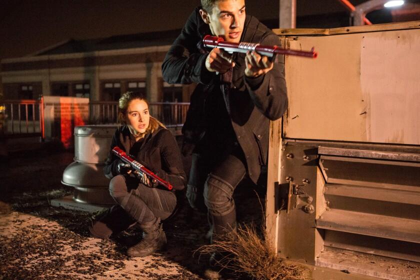 "Shailene Woodley and Theo James in ""Divergent."" Robert Schwentke will direct the sequel, ""Insurgent."""