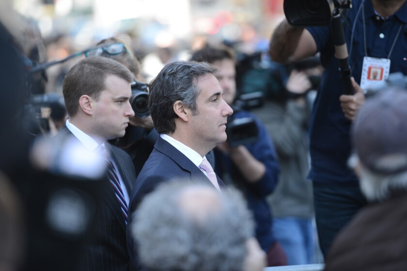 President Trump's former lawyer Michael Cohen has said he is writing a book about Trump.