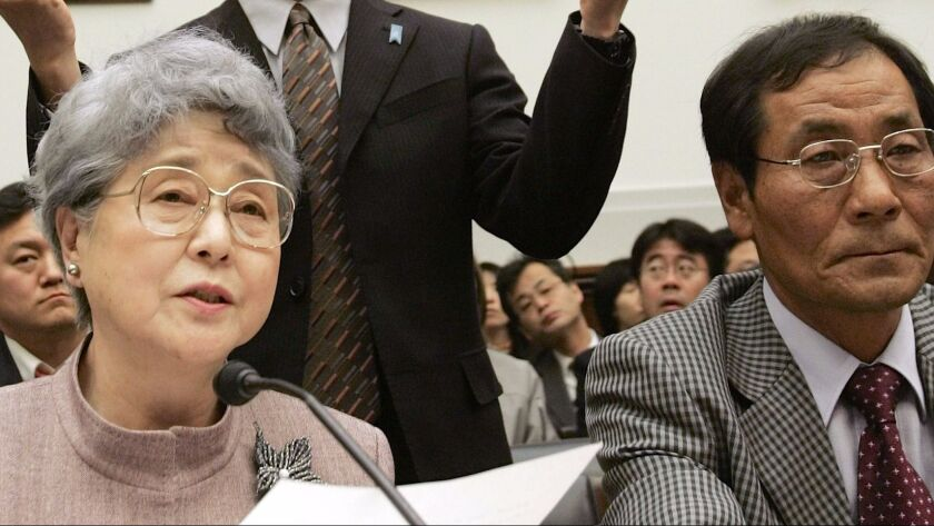 Sakie Yokota testifies before a U.S. House committee in 2006 about the abduction of her daughter, Megumi, by North Korea in 1977. At right is Koh Myung Sup, a South Korean abductee.