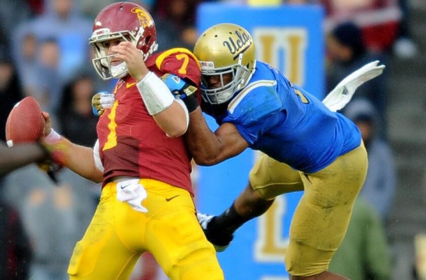 UCLA linebacker Anthony Barr sacks USC quarterback Matt Barkley in the fouth quarter Saturday at the Rose Bowl.