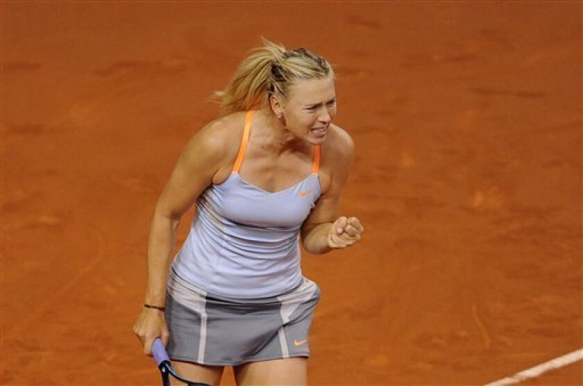 Russia's Maria Sharapova celebrates after defeating Serbia's Ana Ivanovic in their quarter final match at the Porsche tennis GP in Stuttgart, Germany, Friday, April 26, 2013. Sharapova won the match with 7-5, 4-6 and 6-4. (AP Photo/dpa, Daniel Maurer)