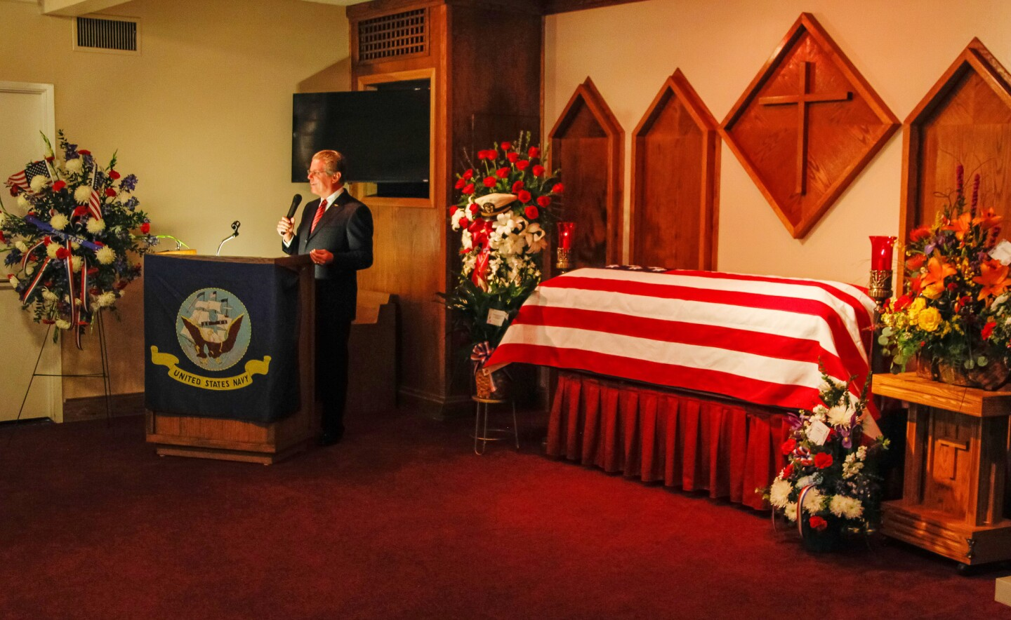 Mac McLaughlin, president and ceo of the USS Midway Museum, speaks during Rudy Matz's memorial service at the Poway Bernardo Mortuary.