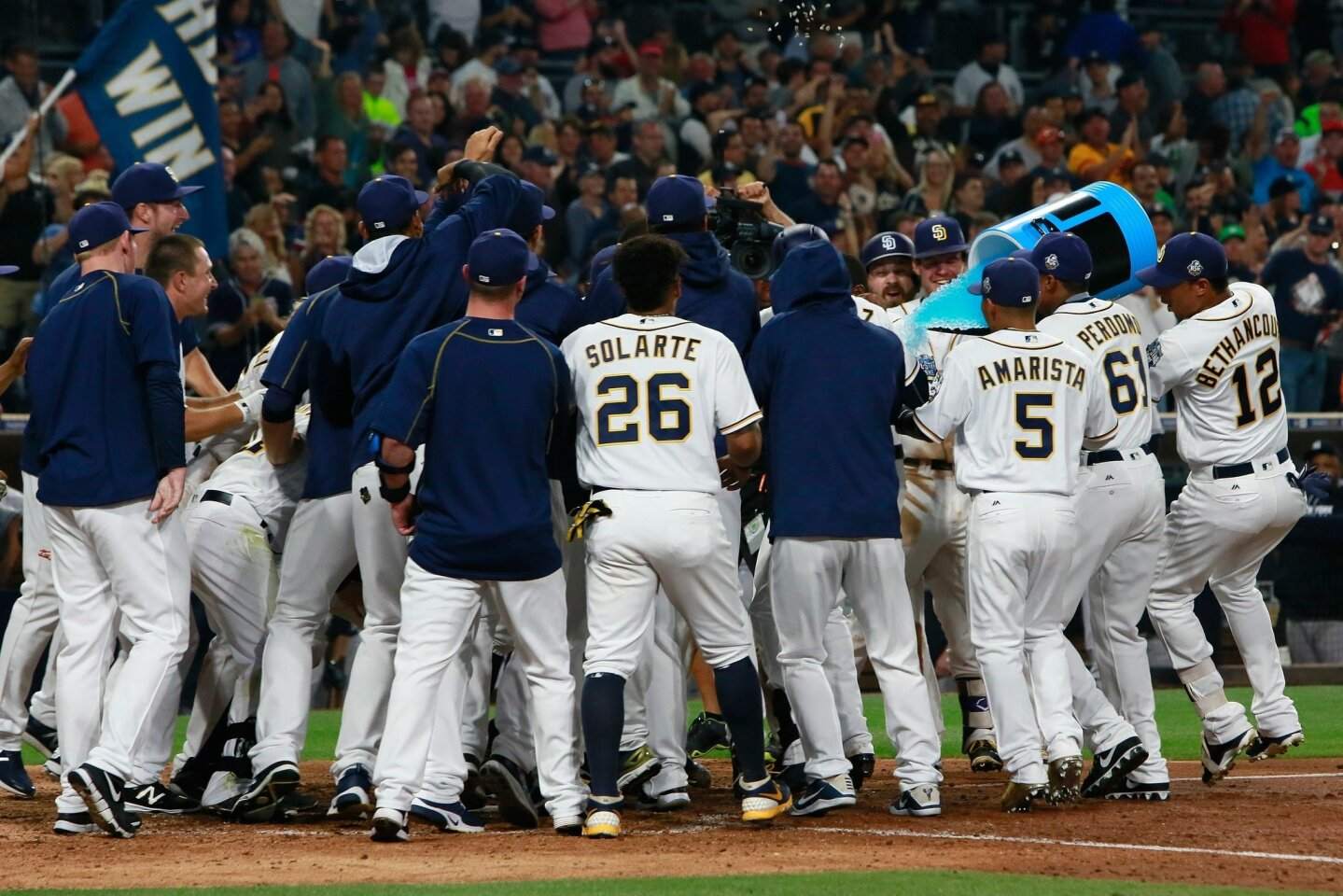 The Padres celebrate after Melvin Upton Jr. hit the winning home run against the Yankees Saturday night at Petco Park.