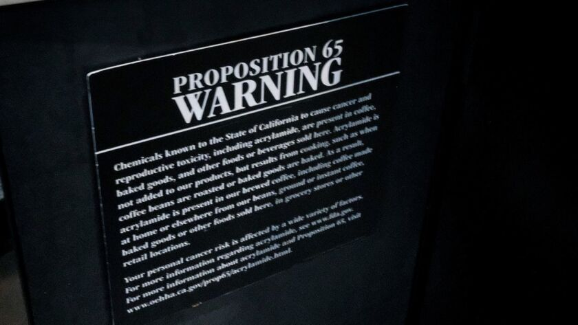 A posted warning sign at a Starbucks coffee shop in Los Angeles.