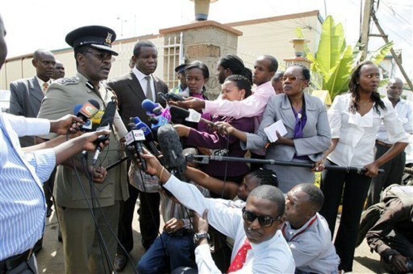 Kenyan Commissioner of Police Mathew Kirai Iteere, left, addresses media on the weekend attack on the police officers in Samburu, northwestern Kenya at Wilson Airport Nairobi, Kenya, Tuesday, Nov. 13, 2012, . Suspected cattle thieves hid on a high hill and ambushed and killed at least 34 police off