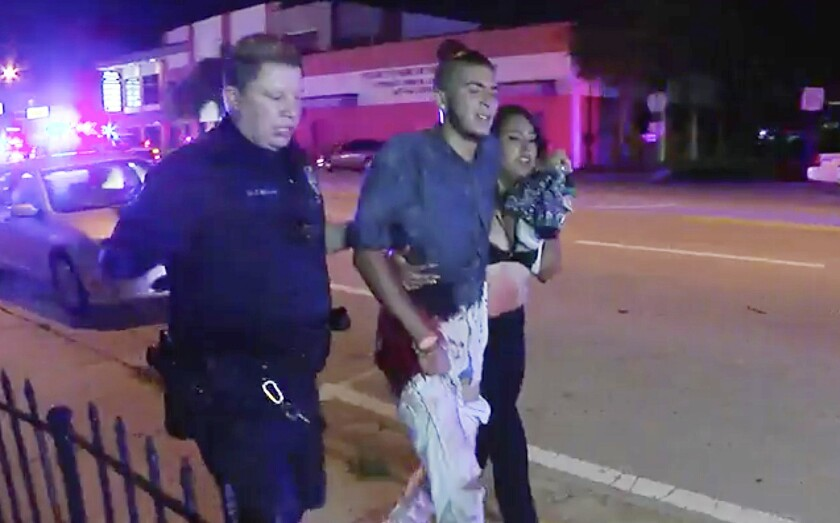 An injured man is escorted out of the Pulse nightclub in Orlando, Fla., after the shooting rampage that left 49 dead.