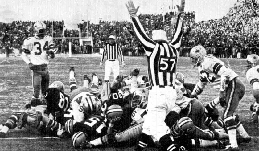 Packers quarterback Bart Starr (15) tumbles into the end zone for the winning score against the Dallas Cowboys in the 1967 NFL championship game in Green Bay.