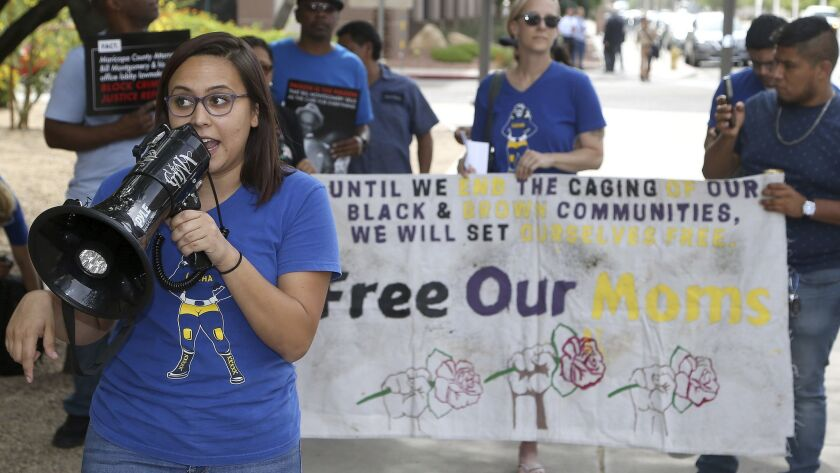 Protesters gather in front of Maricopa County Attorney Bill Montgomery's office Thursday, May 9, 20