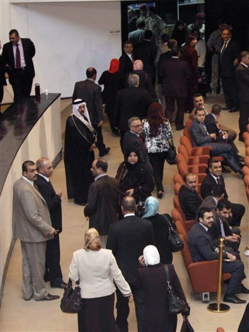 Members of a Sunni-backed coalition are seen as they walk out of of Iraq's parliament session in a protest before a vote on the presidency in Baghdad, Iraq, Thursday, Nov. 11, 2010. A Sunni-backed coalition walked out of Iraq's parliament session in protest Thursday before a vote on the presidency
