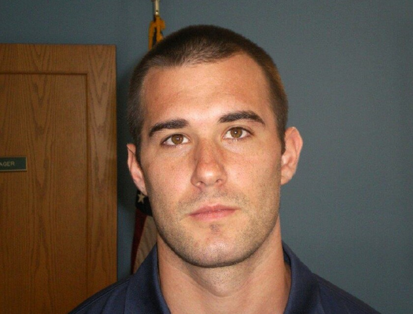 """FILE - This undated file photo provided by the Kingsland Police Department shows Officer Zechariah Presley. A judge denied a former Georgia police officer's request for immunity from prosecution in the fatal shooting of a fleeing, unarmed man after reviewing body camera video in which the officer states: """"He started taking off, so I fired."""" Former Kingsland police officer Presley is scheduled to stand trial starting Monday, Sept. 30, 2019. (Kingsland Police Department via AP, File)"""