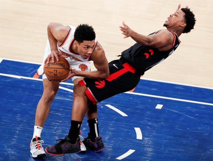 New York Knicks guard Allonzo Trier (L) fouls the Toronto Raptors guard Kyle Lowry (R) during the first half of the NBA basketball game between the Toronto Raptors and the New York Knicks at Madison Square Garden in New York, USA, Feb. 9, 2019. EPA-EFE/JUSTIN LANE SHUTTERSTOCK OUT