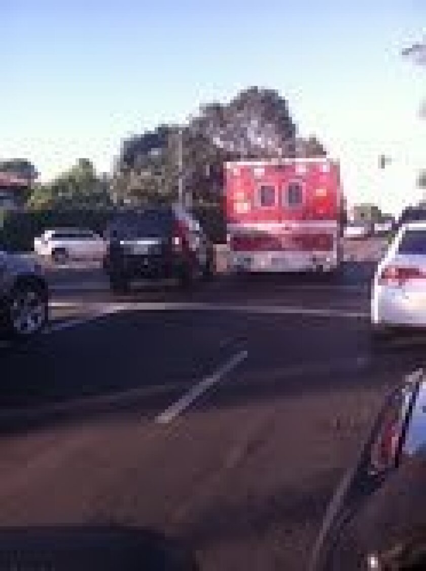 An ambulance negotiates through clogged traffic on Torrey Pines Road. Photo: Kathy Day