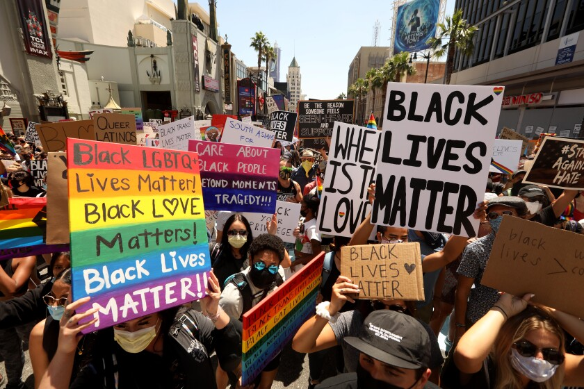 Thousands participate in the All Black Lives Matter solidarity march to mark LGBTQ Pride Month in Hollywood on Sunday.