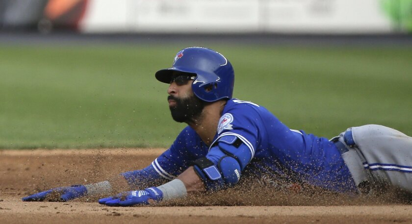 Toronto Blue Jays' Jose Bautista stretches a single into a double as he slides safely into second base during the eighth inning against the New York Yankees in a baseball game Thursday, May 26, 2016, in New York. The Blue Jays won 3-1. (AP Photo/Julie Jacobson)
