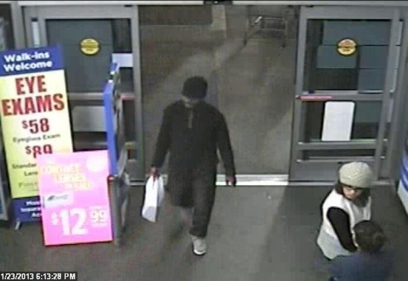 A surveillance photo of the suspect from a Walmart robbery in Oak Park in November 2013.  / San Diego police and Crime Stoppers
