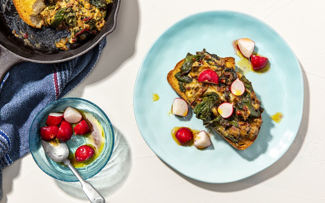 Crisp radishes that serve as a foil to thick toast topped with Swiss chard greens mingled with Swiss cheese.